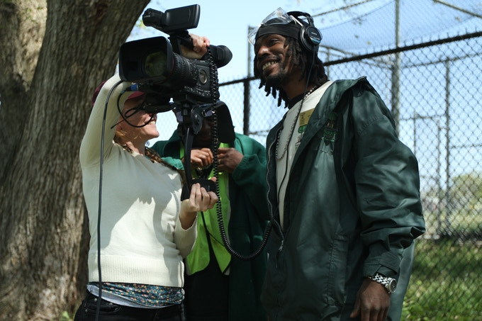 Director of Photography Ellie Walton sharing footage with lead participant Michael Samuels in Marvin Gaye Park.