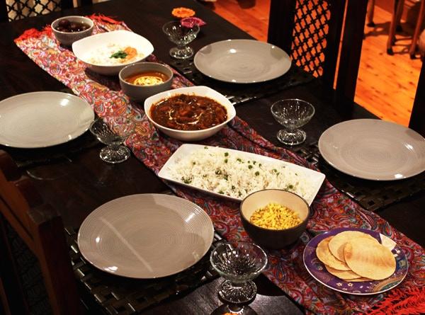 A Curry Delights Meal: Papad, Khatta Meeta snack, Peas Pulao, Butter Chicken, Dal Makhani, Boondi Raita and Gulabjamun