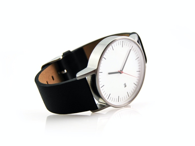 Matte silver bezel with black leather straps