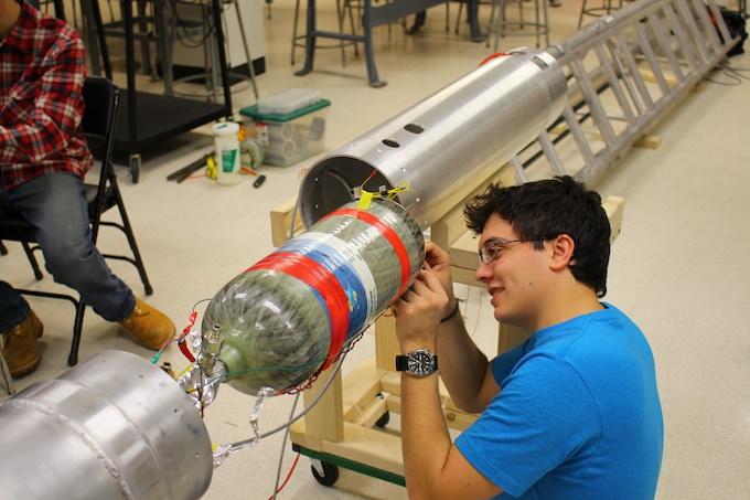 Student installing electronics on the Mk IV motor