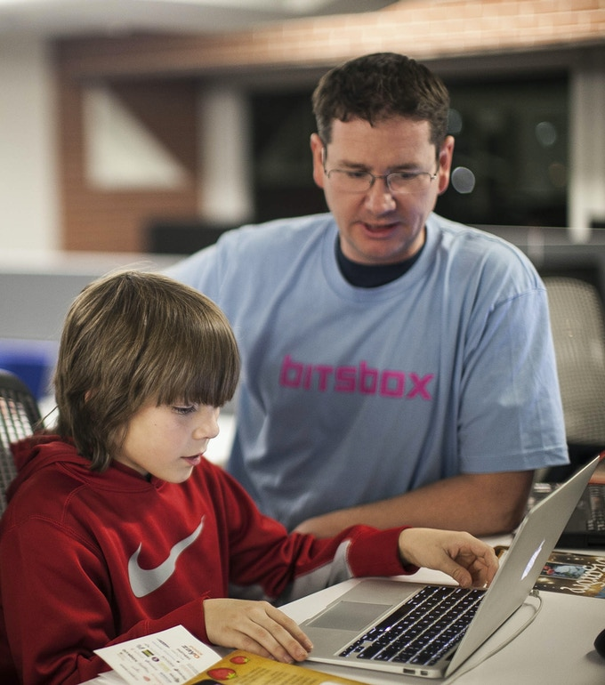 Scott and a CSED participant write an app at a Computer Science Education Week kick-off event in Boulder, Colorado. 12/8/14