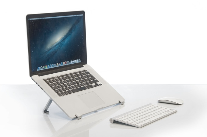 SUAS raising a MacBook Pro to the perfect viewing height.