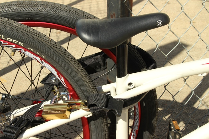 """The Mighty Click bike chain is 32"""" long, so you can secure your bike but still easily take it with you. It weighs 3 pounds, 4 oz with the lock, or 2 pounds, 8 oz without. It will fit from a 26"""" to a 38"""" waist with the belt clip."""