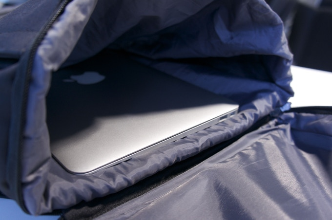 "We used a 11inch Macbook Air as a size reference for the bottom compartment and expandable divider (""shoe pocket"")"