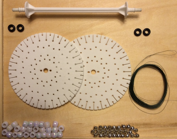 Here is the DIY kit: Rod, 2 Discs, 2 Strings, 4 O-rings, 56 Plastic Beads, and 28 Metallic Beads (for $2 upgrade fee).