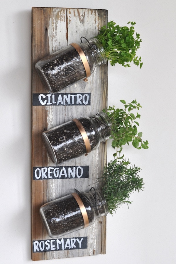 Three-jar vertical wall hand-crafted from reclaimed lumber