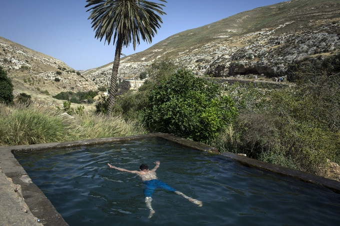 A Palestinian youth from Hebron enjoys a swim in Ein Fara, one of the most beautiful nature spots in the entire West Bank. It, like many other nature reserves and heritage sites in the West Bank, is managed by the Israeli Nature and Parks Authority