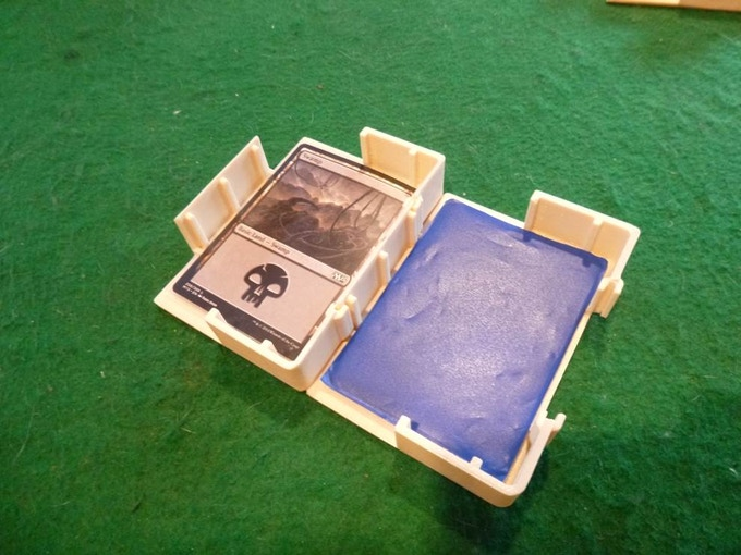 The Card Caddy perfectly fits a standard deck or a 40-card deck of double-sleeved trading cards - double and even triple decker versions can be unlocked if we meet the stretch goals