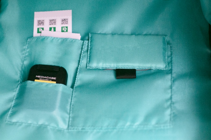 Interior sleeve pockets hold business cards, SD card cases, CF cards, or other small items. The larger expandable velcro pocket can hold large lens caps, lens filters, and other accessories up to 105mm wide.