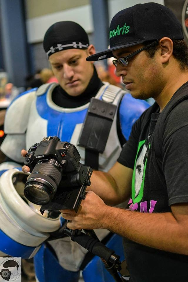 FD Sedano Arts showing a cosplayer his section of a video, photograph by Travis Photography