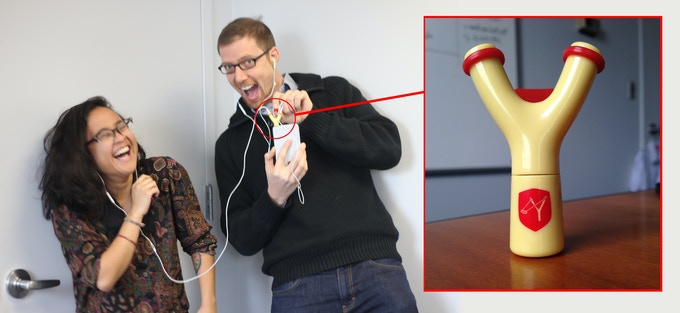 Host Ben Wikler and Production Coordinator Harum Helmy enjoy their new Headphone Splitter of Justice