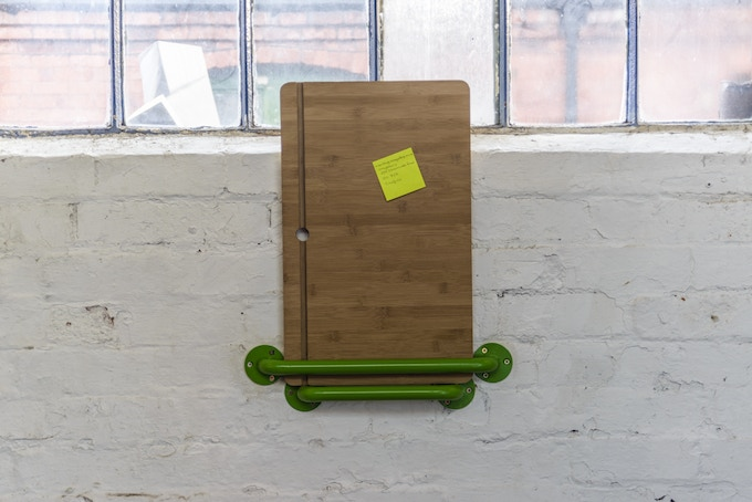 The Portable Lap Desk Installation No.1 takes little space when stored on the wall