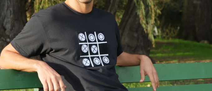 Each Tic Tac Toe Tee comes with eight velcro-backed playable pieces.