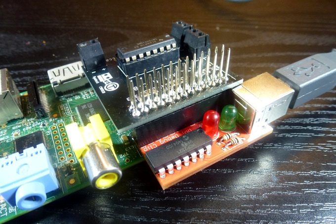 Raspberry Pi Debug Clip sandwiched between Raspberry Pi Model B & Ryanteck Motor Controller Board