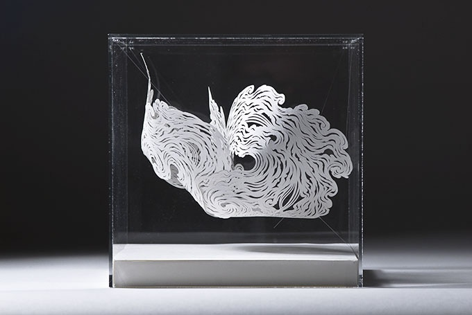 Nebula by Andy Singleton. Hand-cut paper in perspex case, 20 x 20 x 20cm.