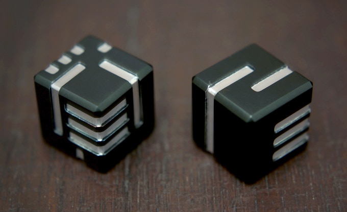 A set of AKO DICE with black anodized finish.