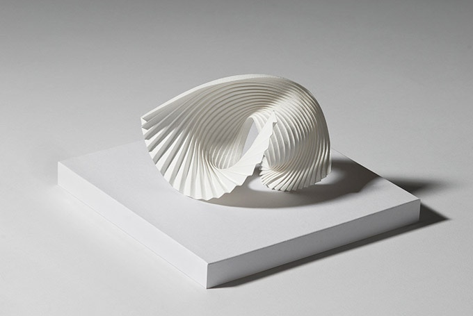 Motion by Richard Sweeney. Wet-folded watercolour paper in perspex case, 20 x 20 x 20cm