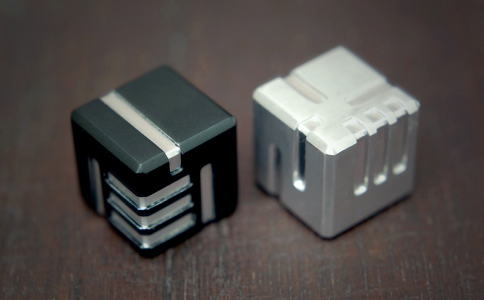 A set of AKO DICE with black anodized and natural finish.