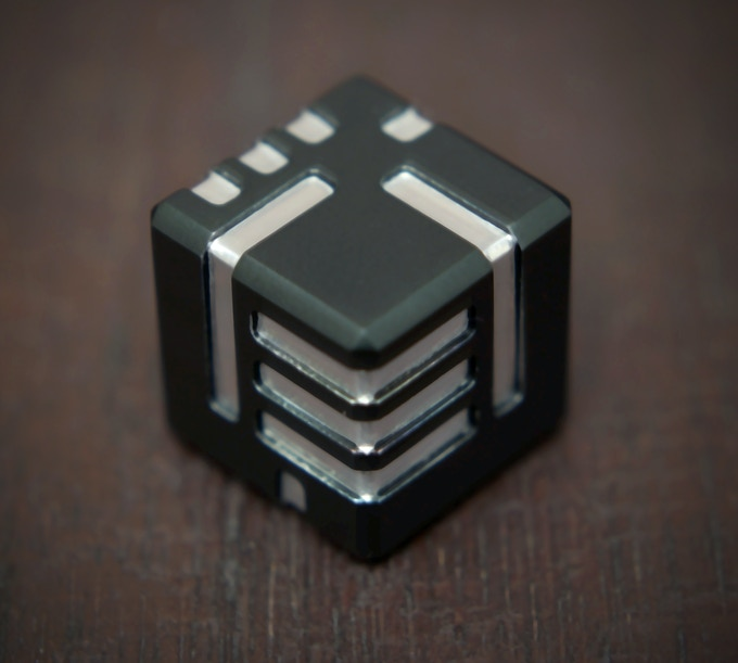 Close up AKO DICE with black anodized finish.