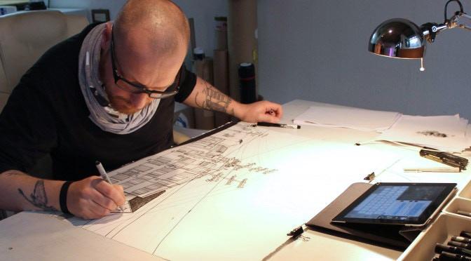 Berlin artist Christian Rothenhagen working in his studio