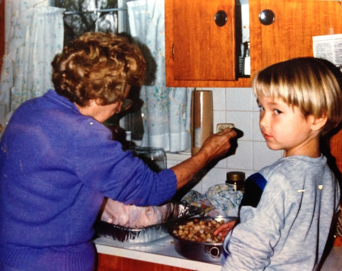 A young Chef Nicholas in the kitchen with his Grandma Stoltz
