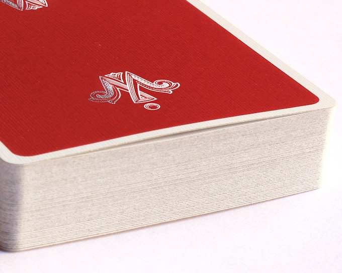 Imp Red with Silver Foil Logos stamped onto the playing card back
