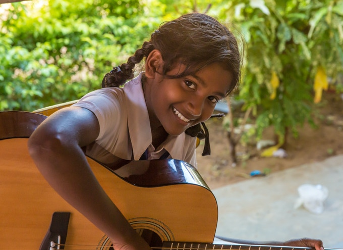 A young girl at The Music Project learning her first chords on guitar. I took this image in September 2014 while location scouting for Travel Global Think Local in Sri Lanka. This is a view of what we hope to capture with the help of your pledge.