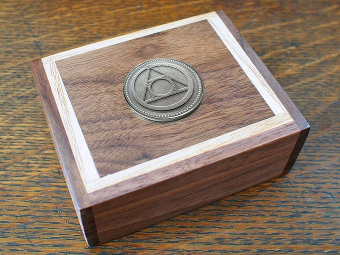 Please note: The medallion in this image was comped, the box is a real prototype. Wooden box does not include cards.