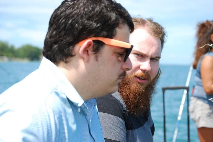 Joshua Steward and Thomas Nudi discuss a location.