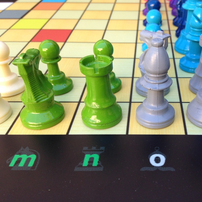 """The Green """"n"""" with the rook shadow tells a player to place the Green rook at that square at the start of the game..."""