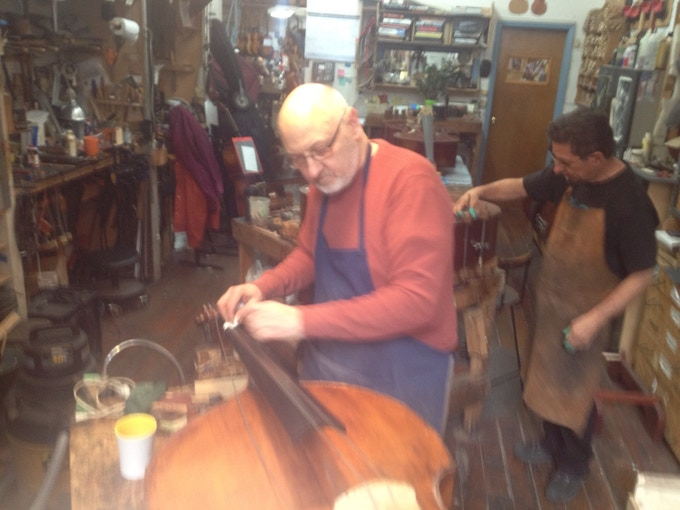 """Master Repairman Mike from David Gage Basses surveys the condition of the """"patient""""...."""