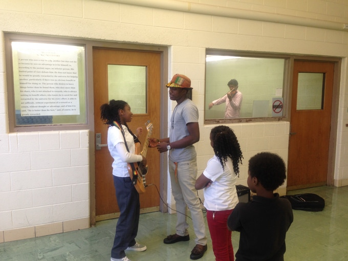 Students learning the electric bass in Brightmoor