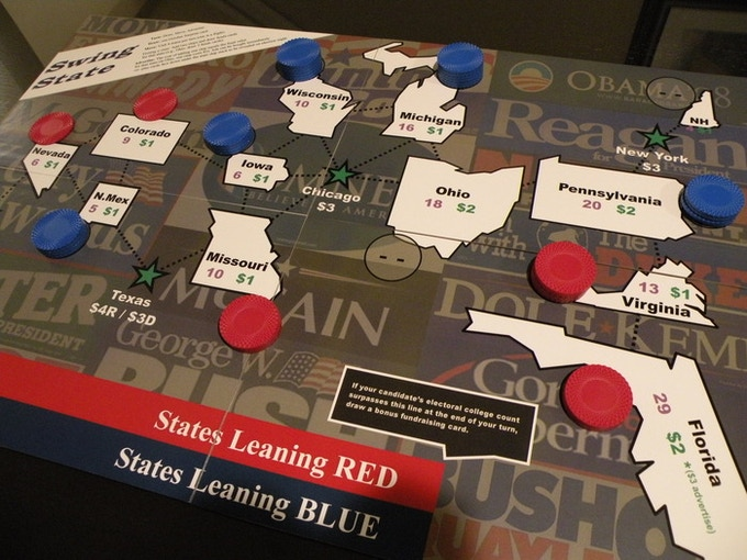 Before the game begins, the board looks like this. Red is naturally ahead in some polls, Blue in others, but they are tied in Ohio (notice no chips there).