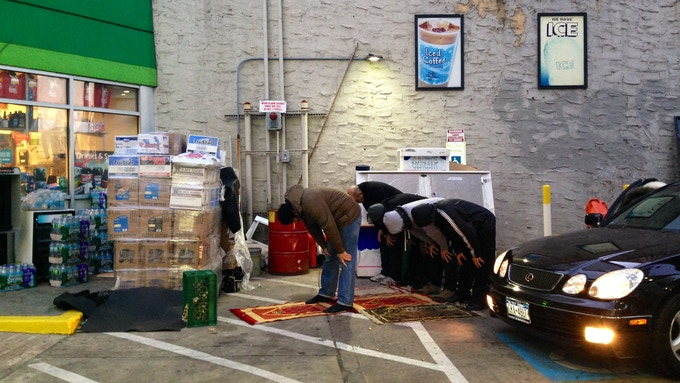 Muslims in NYC turning a garage into a makeshift musallah. (Credit: Public Radio International)