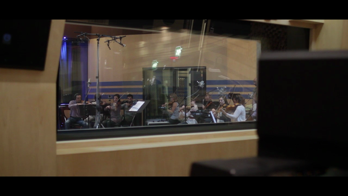 A picture of our orchestra recording at the studio. (seen from inside the booth)