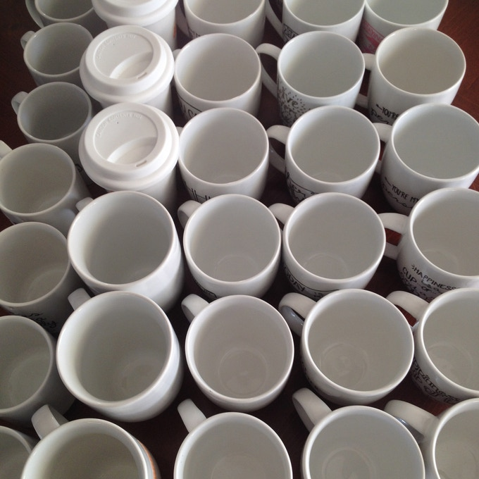 over 50 mugs painted and baked in 4 days for the Fall Market with the Shops @ Yale