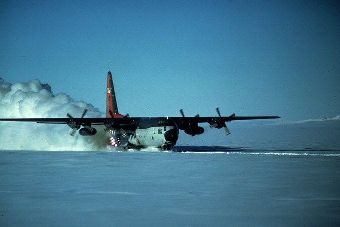 U.S. Navy VXE-6 LC-130 firing Jet Assisted Take Off (JATO) on the Orville Coast, Operation Deep Freeze, 1977 (Mike Boyles)