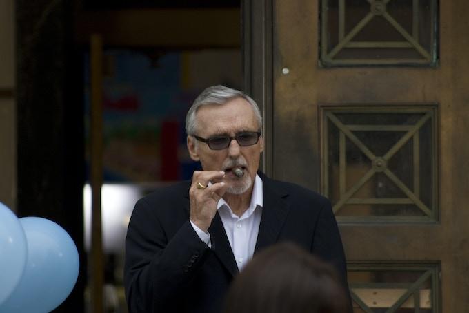 Dennis smokes his favorite cigar