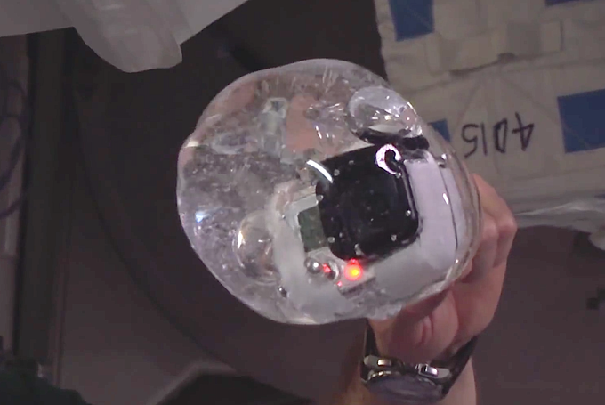 Water bubble in weightlessness. Yes, that is a camera stuck inside the bubble.