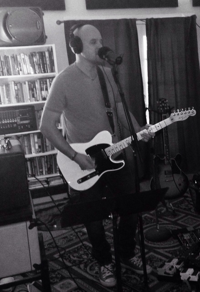 John playing said guitar on the new record
