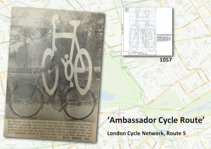 Ambassador Cycle Route 1981 - Ken Clarke, British Minister for Transport, riding while carrying a bike sign.