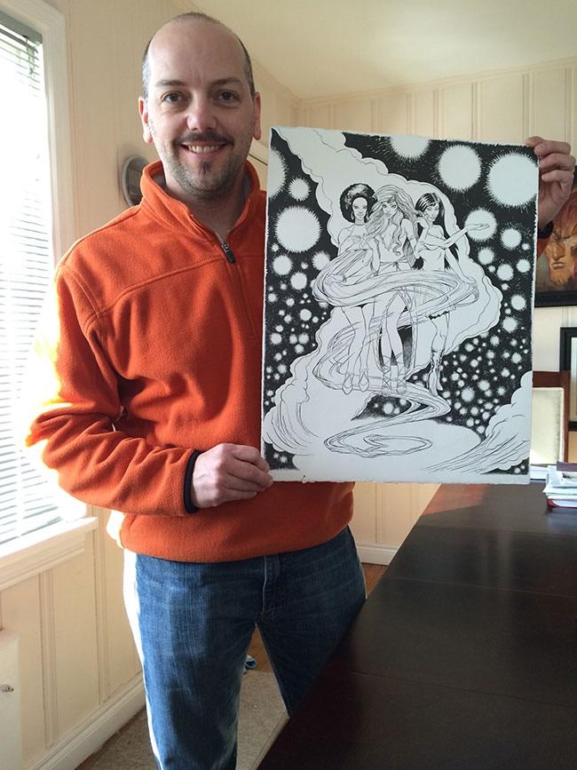 Jeff holding the original brush & ink art for Venus.