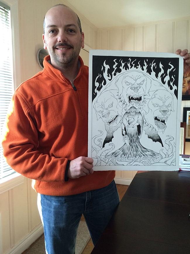 Jeff holding the original brush & ink art for Pluto.
