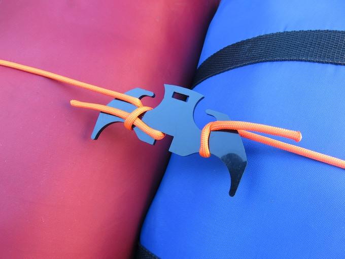 The Cross Hook doubles as a gear tie when it's not a grappling hook! Shown in Delrin.