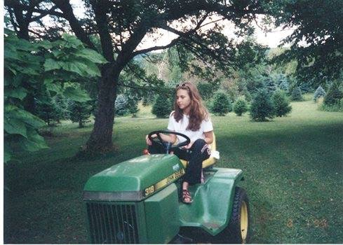 Amanda (myself) mowing McHugh Family Trees in Buffalo at the age of 12.