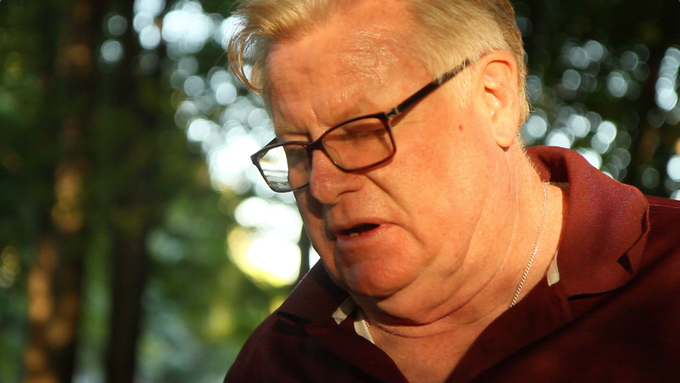 Screenshot from the film. Terry reflecting on the year's struggles before going into a meeting with the Town Board of Appeals that will affect the rest of his life.
