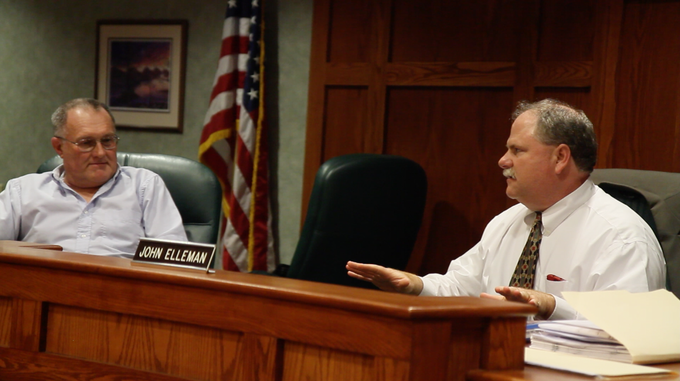 Screenshot from the film. Two members of The Town Board of Appeals discussing Terry's case.