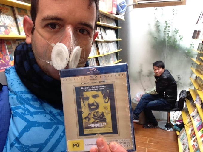 Our crew mate Roger Vicente (in polluted Beijing) holding the rare BR copy of Duel.