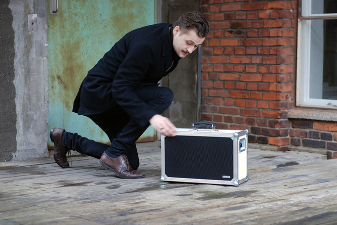 Mikkel spit shining an Audiocase for the photo shoot