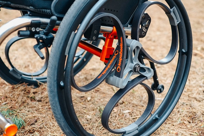 Shock-absorbing Loopwheels for wheelchairs